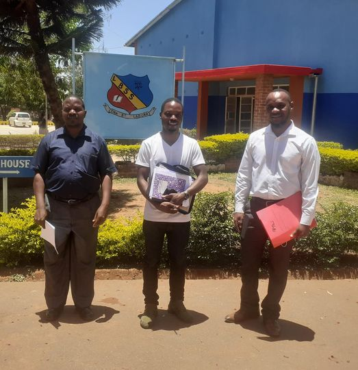ICT Officer from Centre for Youth and Development with Officers from CWED on one of their visits to schools.