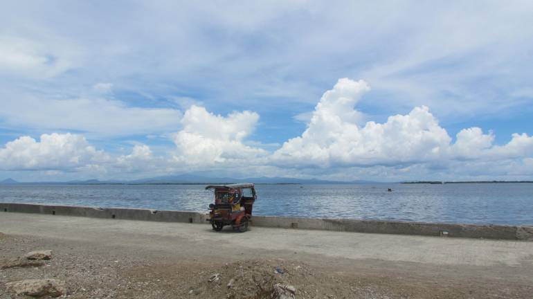 A tricycle parked at R.T. Lim Boulevard, Zamboanga City