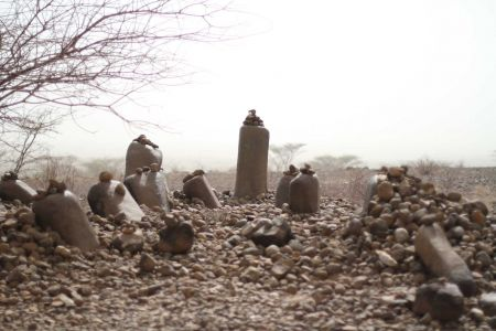 Kalokol Namoratunga emerge from the haze of a duststorm, north of the Turkwel river in west Lake Turkana.