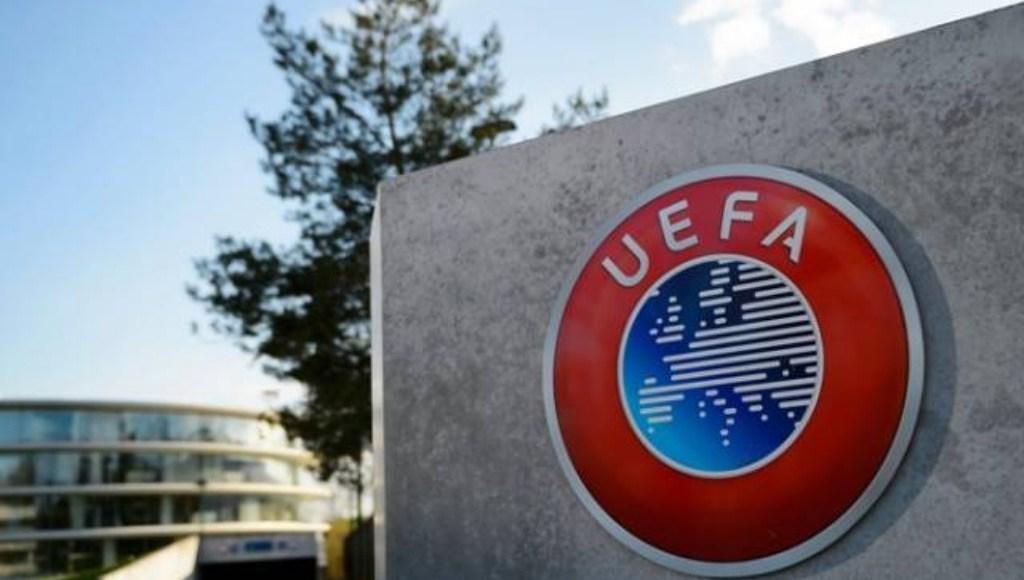 UEFA logo on a wall.