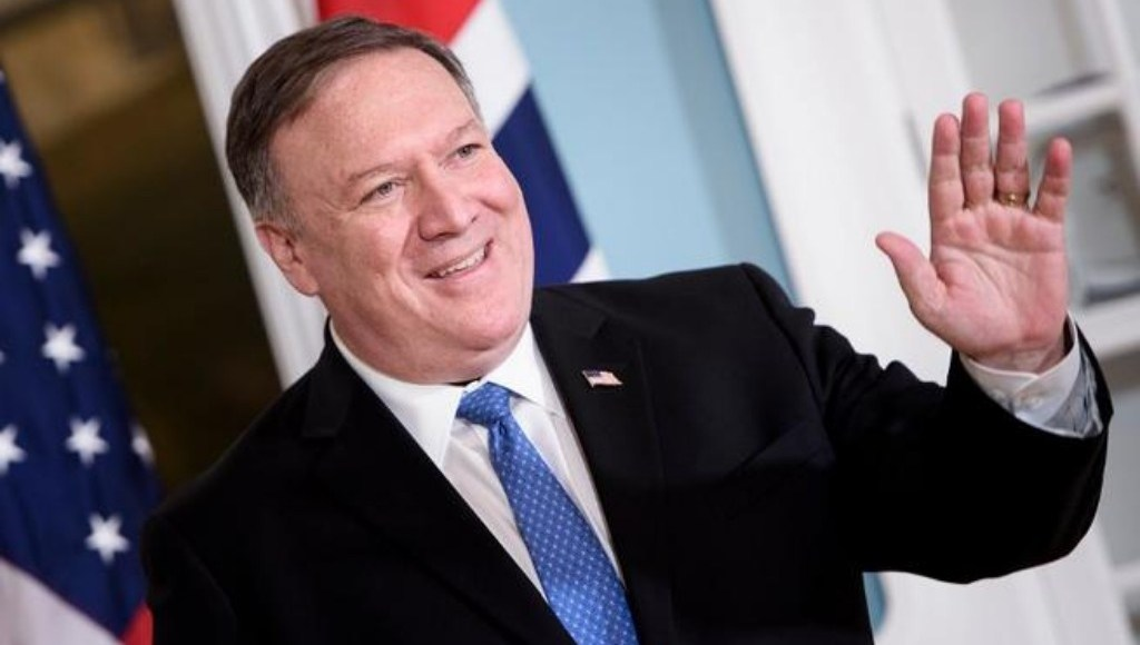 U.S. Secretary of State Mike Pompeo smiling at cameras.