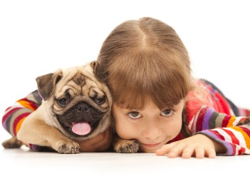 bigstock_Little_girl_and_the_Pug-dog_is_17575418