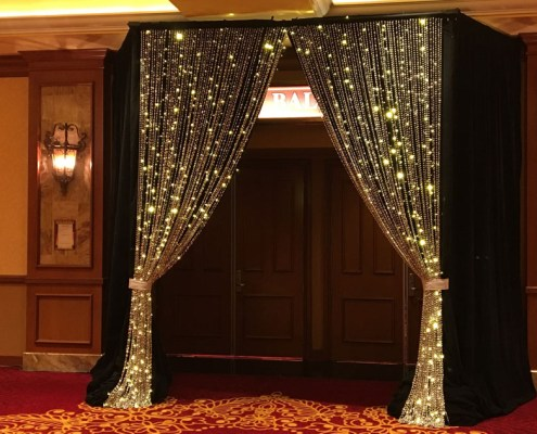 Swagged Silver Beading With LED Lighting and Black Velvet Drapery