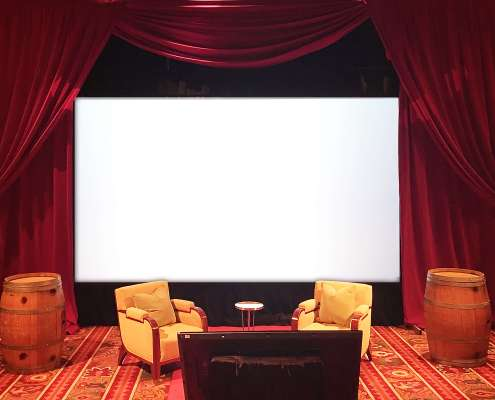 Movie Screen flanked by Red Velour / Red Velvet Drapery From Turn of Events Las Vegas Rental Drapery