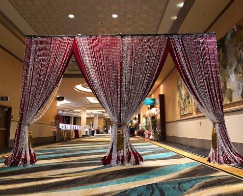 Iridescent Beads over Red Velour / Red Velvet Event Entrance From Turn of Events Las Vegas Rental Drapery