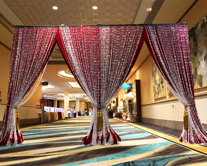Red Velour Drapery Entrance adorned with Iridescent Tear Drop Beading Divider from Turn of Events Las Vegas