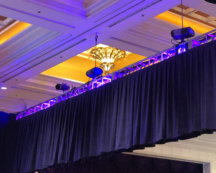 Purple Velour Drapery Hanging From a Truss from Turn of Events Las Vegas