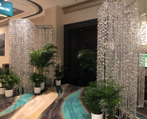 Silver Tear Drop Beaded Columns Flanking Event Entrance From Turn of Events Las Vegas Rental Drapery