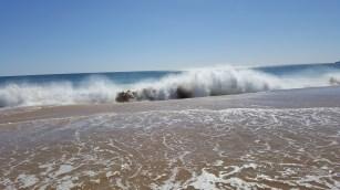 Waves crashing on Alvor South beach
