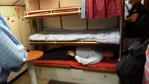 A fellow visitor trying out the bunks on HMS Ocelot