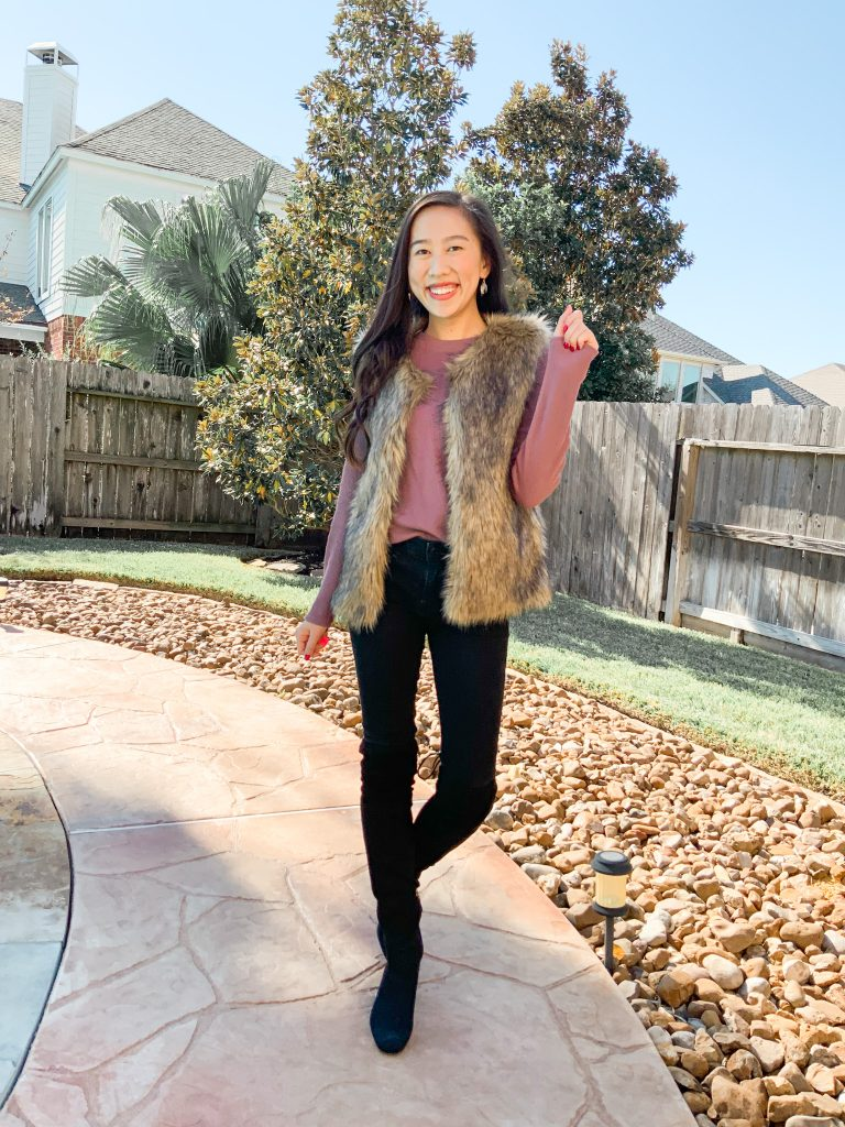 faux fur vest and black skinny jeans outfit