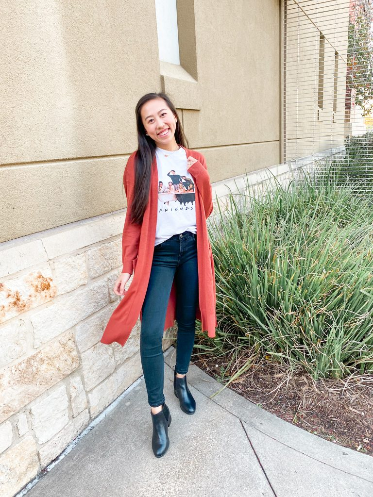 burnt orange cardigan and friends t shirt outfit