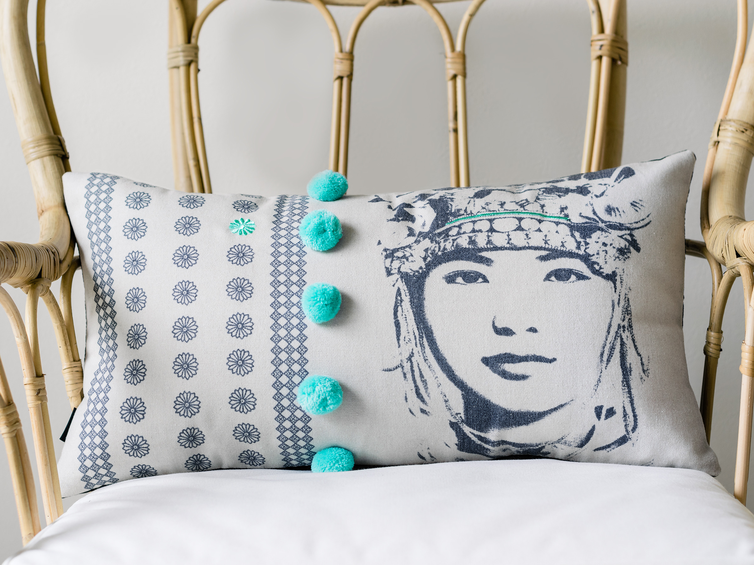 pom pom cushion cover face turquoise