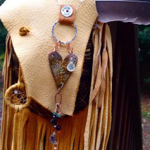 Enameled heart with sterling bail and leather detail. Cowgirl love
