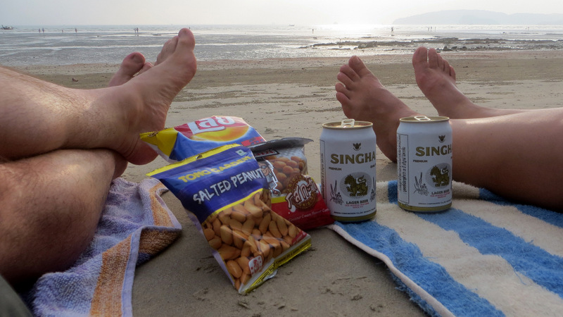 Taking a break from street food with a junk-food picnic on Nopparat Thara Beach, Ao Nang, Thailand.