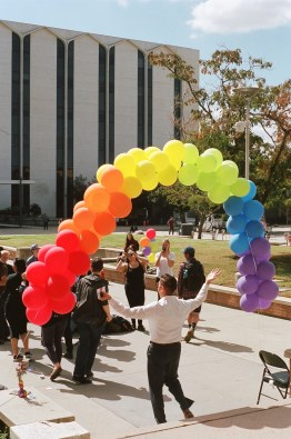 The balloon arch was not only the focal point of the celebration but an essential prop in the festivities.