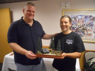 Paul receives his first place prize from TD Chuck Tewksbury