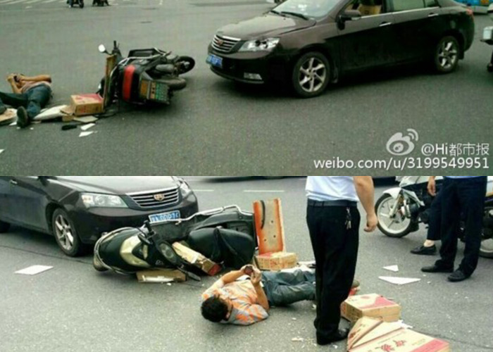 Man Crashes Motorbike and then Plays With Phone While Laying in Road