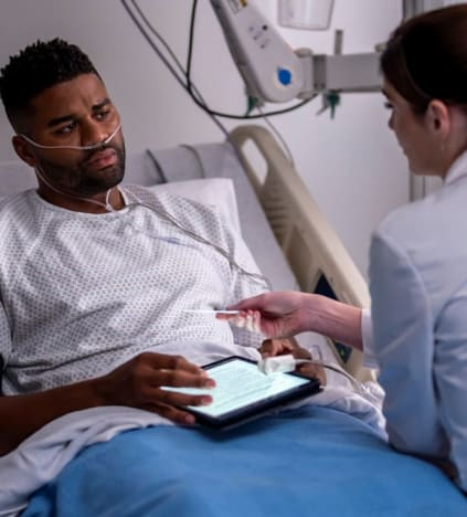 Bloom Bonds with a Patient - tall  - New Amsterdam Season 4 Episode 1
