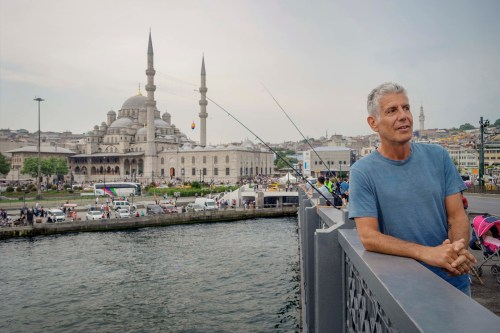 Anthony Bourdain: Parts Unknown - 315 - Istanbul Tony on the Galata Bridge in Istanbul with the Yeni Cami Mosque in the background.