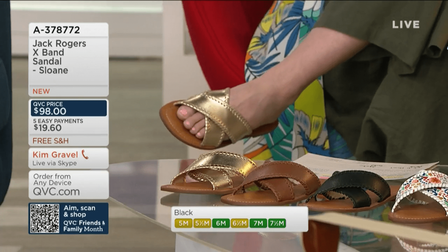 Close-up shot of QVC show host Katrina Szish's feet during an on-air presentation.