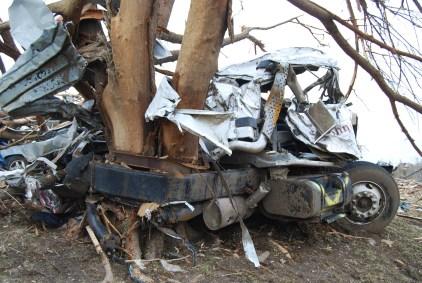 A semi-truck wrapped around a tree in Joplin, MO
