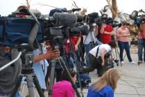 Media covering tornado news conference