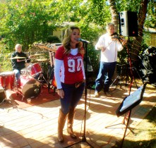 Mary Cogan sang at the tailgate party