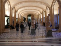 A statue gallery inside the Louvre, Paris