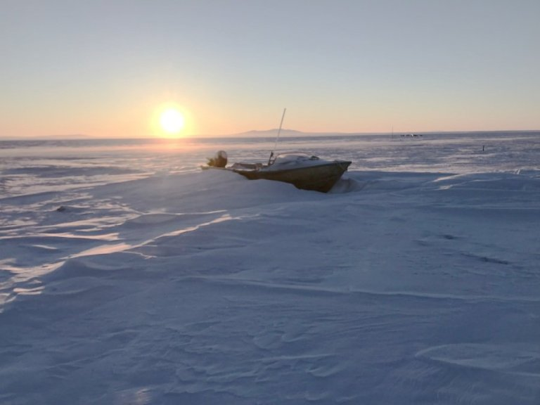 ship stuck in iceburg