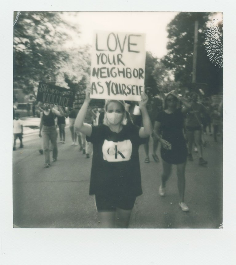 protest sign love your neighbor as yourself