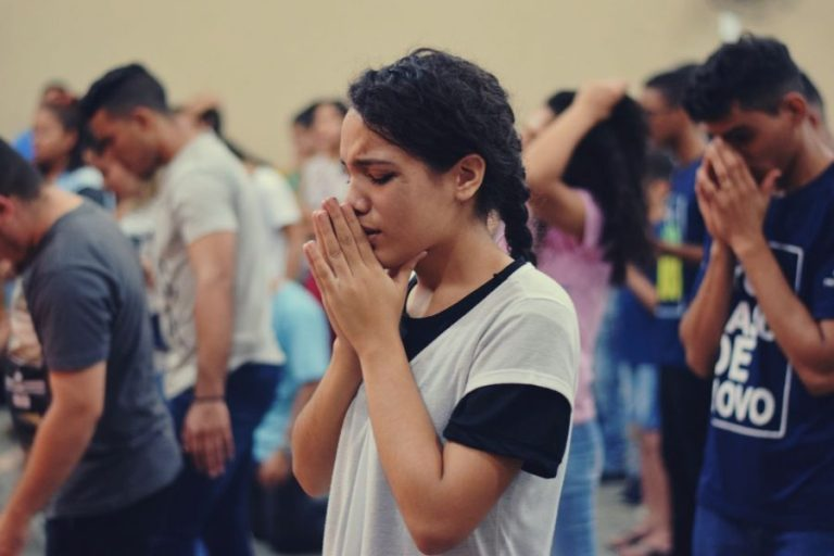 woman in group prayer