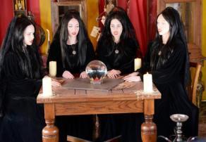 The Four Who Speak as One gather around a crystal ball on  Sleepy Hollow.