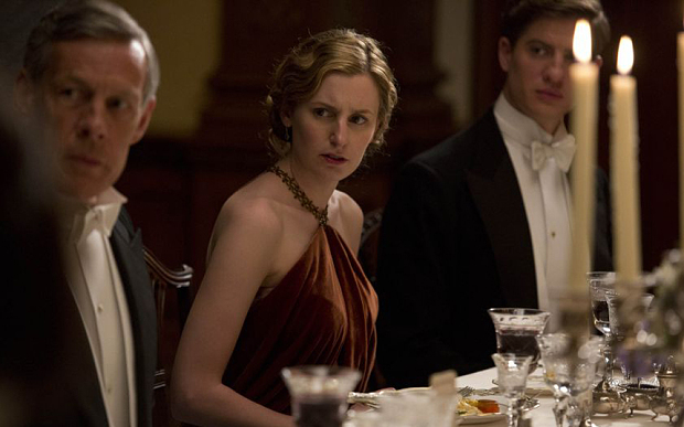 A rude dinner guest makes Lady Edith frown on Downton Abbey