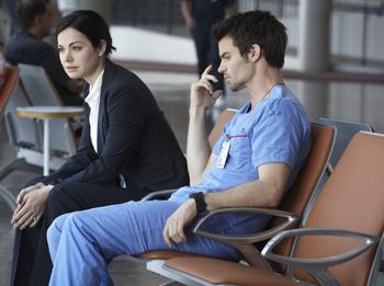 Erica Durance as Alex Reid, Daniel Gillies as Joel Goran