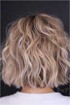 1 layered short haircut with ash brown color source glaminati.com