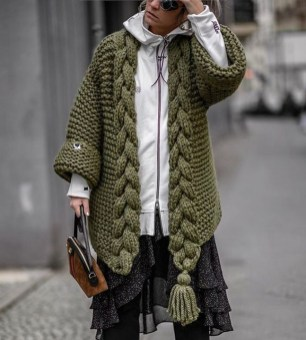Layered knitwear with a white zipper hoodie