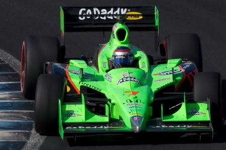 Danica Patrick taking a hairpin turn in an Indy racing car