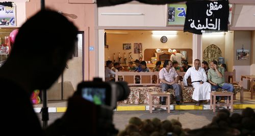 "A view shows actors during the filming of the set of the television series, whose title is loosely translated as ""State of Superstition"" in Baghdad"