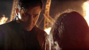 Flynn confronts Lucy as the Hindenburg burns in the distance.