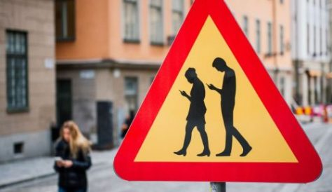 TOPSHOT - A road sign Warning Against pedestrians focusing on their smartphones is pictured on February 2, 2016 near the old town in Stockholm. / AFP / JONATHAN NACKSTRAND        (Photo credit should read JONATHAN NACKSTRAND/AFP/Getty Images)