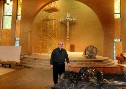 Father Pat Garrett looked over the renovations in 2013 in the the sanctuary at Sts. Simon and Jude Catholic Parish, 26777 Glen Loch Drive.
