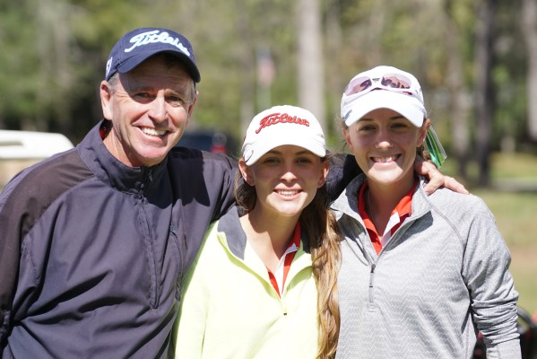 The Bruner sisters celebrate with their Dad