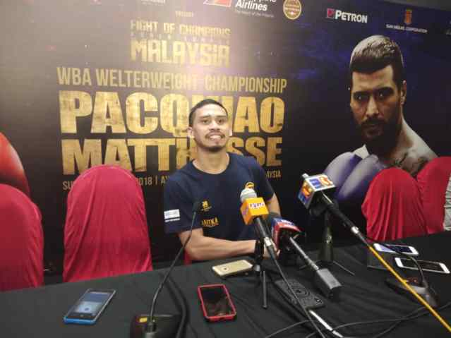 Aiman Abu Bakar speaks to the media after beating Indonesia's Abdi.