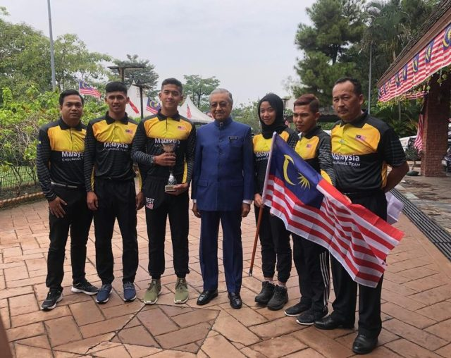 Tun Dr Mahathir Mohamad with national equestrian team