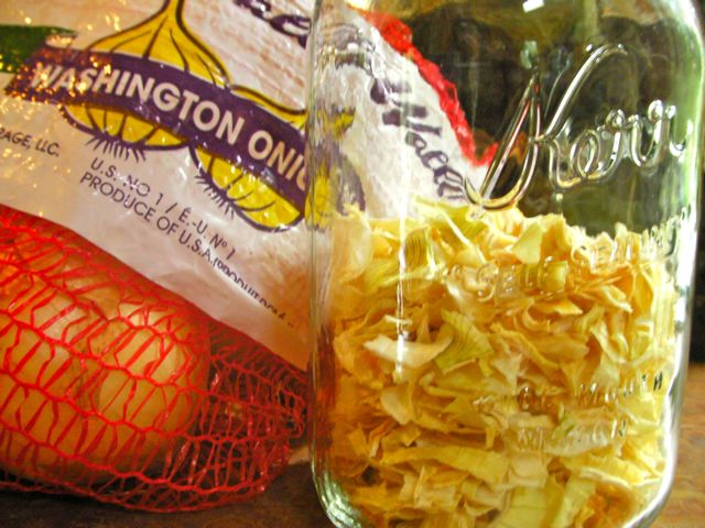 Bag of Walla Walla sweet onions and a jar of just-dehydrated onions for winter storage