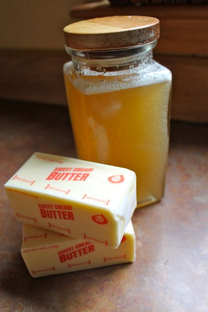 Container of honey and a stick of butter