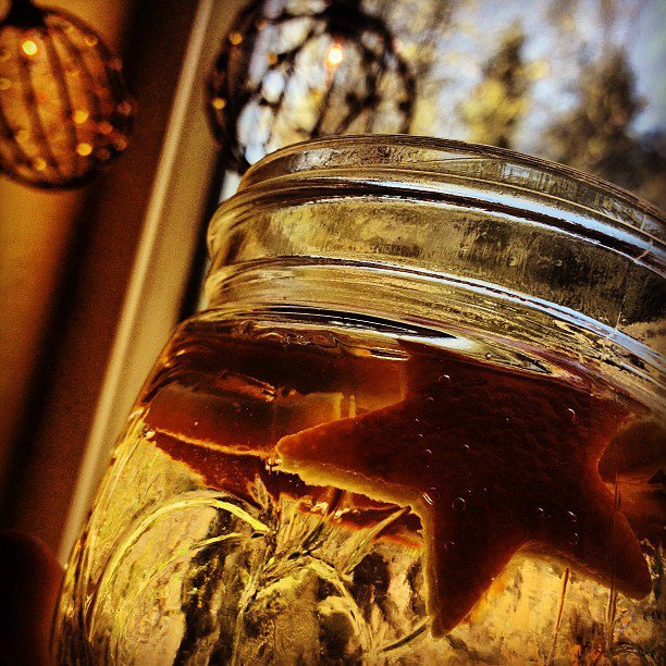 Orange stars in vinegar -- jar
