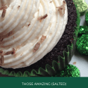 Partial view of Irish cream cupcake with chocolate shavings sprinkled on top