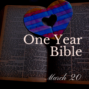 Open Bible with blue and red heart sitting on the pages
